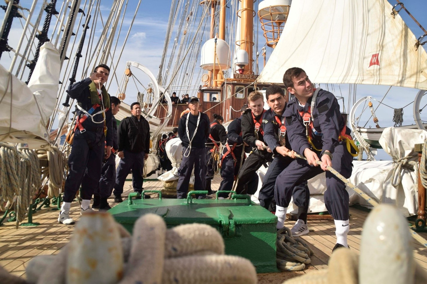 NCdt Isaac Goggin raising the sails of the Chilean tall ship Esmeralda alongside officers from Chile, Brazil and Portugal. NCdt Goggin joined 20 other international sailors and 60 Chilean midshipmen in a training voyage across the Pacific in the summer of 2019. Image supplied by NCdt Isaac Goggin