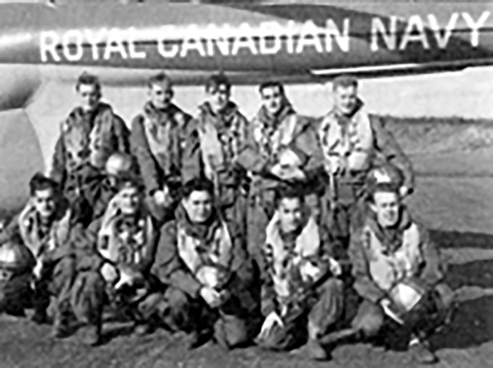 A specialist in anti-submarine techniques, Ted Jamieson instructed sailors aboard the Iroquois during the Korean War. He later joined a helicopter anti-submarine squadron. Jamieson is in the front row, centre, of the photos of the sonar air crewmen of the 50th Squadron. (George C. Apps / Library and Archives Canada / PA-146296)
