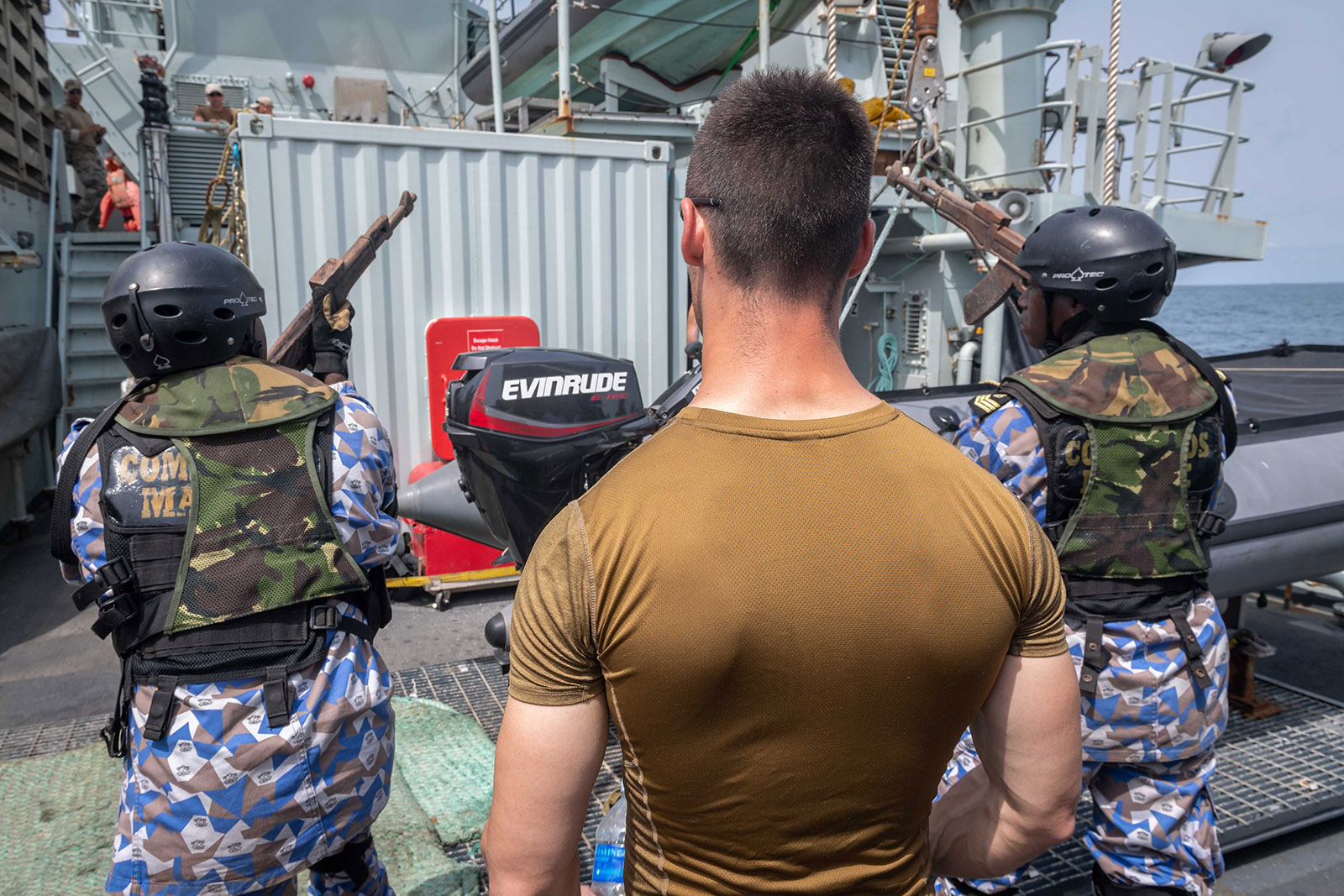 A member of the Naval Tactical Operations Group mentors members of the Marine Nationale du Côte d'Ivoire during a boarding exercise in HMCS Kingston on March 16, 2019.