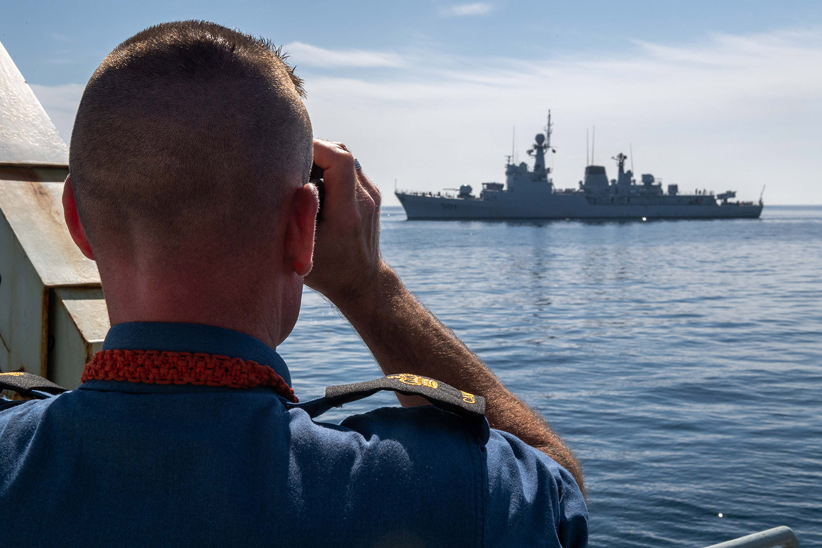 Petty Officer First Class Chris Oldham, coxswain of HMCS Kingston, watches Royal Moroccan Navy ship Lieutenant-Colonel Errhamani during PHOENIX EXPRESS 19 in the Western Mediterranean Sea on April 3, 2019.