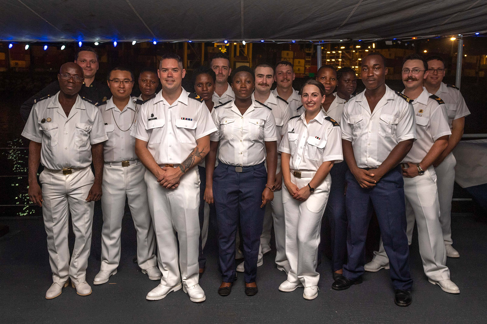 Togolese and Canadian sailors pose for a photo during a reception onboard HMCS Kingston in Lomé, Togo on March 5, 2019.