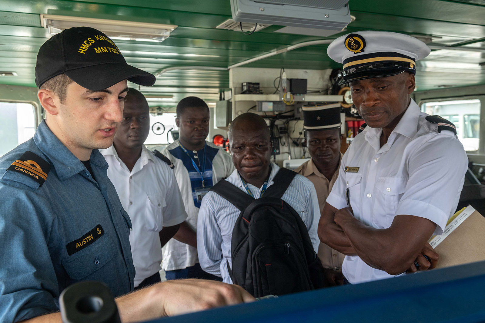 HMCS Kingston Navigating Officer Lieutenant(N) Graham Austin discusses search-and-rescue strategies with Togolese military and government personnel on March 7, 2019.