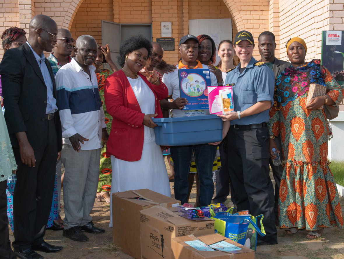Colonel Mireille Gignac and Lieutenant-Commander Teri Share present donated supplies to staff at the Lycée Moderne de Jeunes Filles in Abidjan, Côte d'Ivoire during Operation PROJECTION West Africa on February 23, 2019.