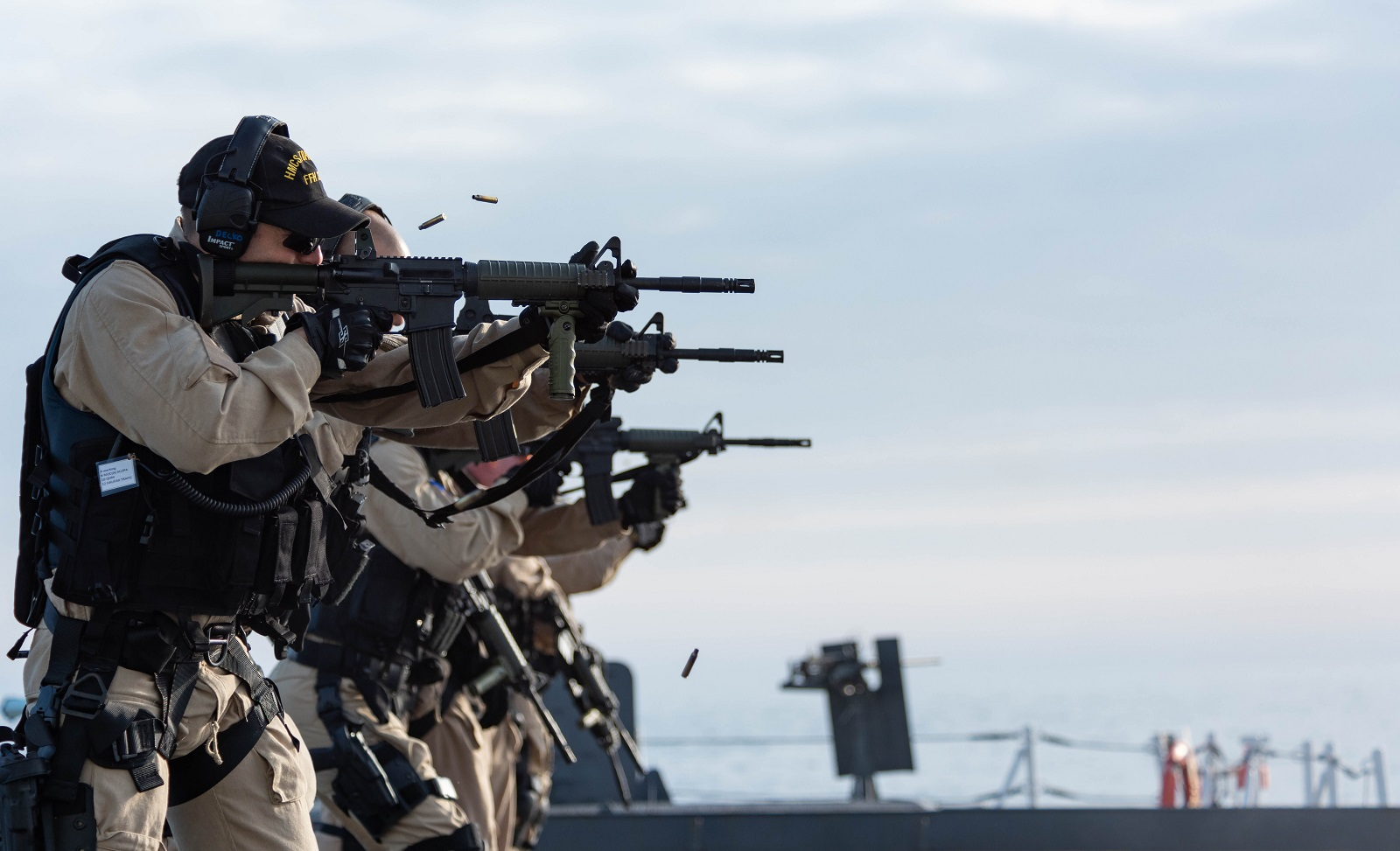 Members of HMCS Toronto's Naval Boarding Party fire the C8A2 assault rifle during weapons training on the flight deck on April 8, 2019.