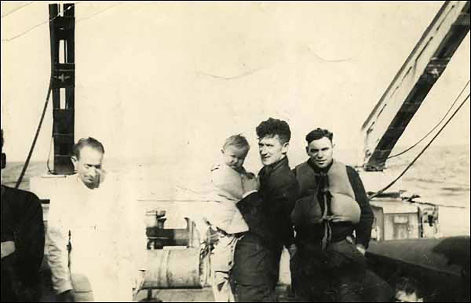 Unidentified survivors of SS Caribou, which sank off the coast of Newfoundland on October 14, 1942 after being torpedoed by a German submarine. Of the 237 people on board, only 101 survived. Photographer unknown. Reproduced by permission of Archives and Special Collections (Coll. 115 16.07.034), Queen Elizabeth II Library, Memorial University of Newfoundland, St. John's.