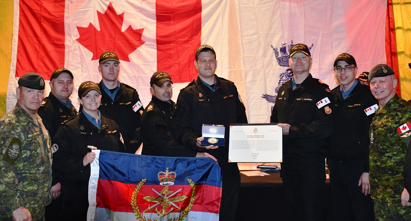 The current crew of Her Majesty's Canadian Ship St. John's accepts a unit commendation from the Chief of the Defence Staff, General Jon Vance, on behalf of the crew that carried out meritorious action during Op RENAISSANCE Irma Maria in fall 2017.