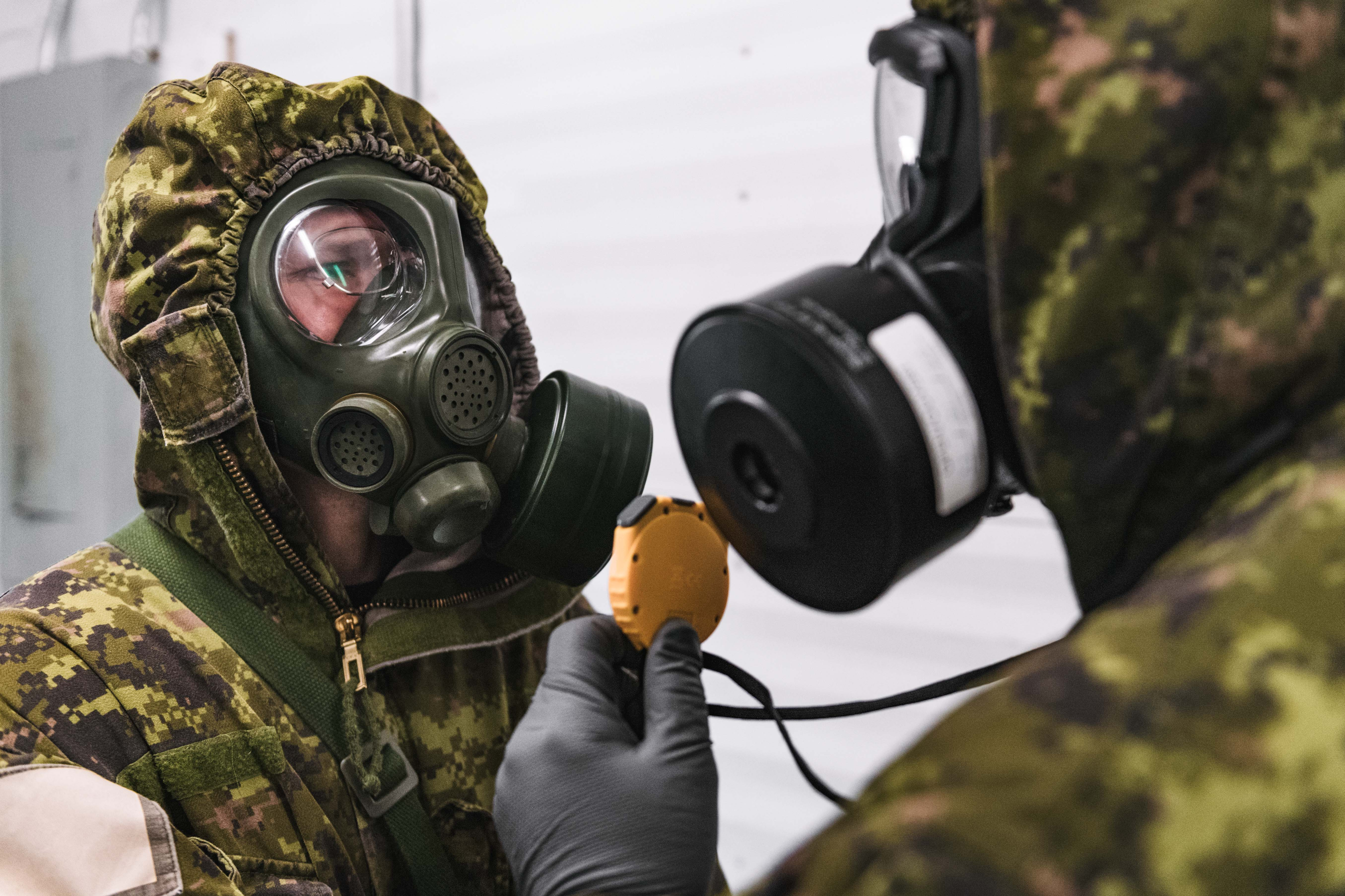 A recruit takes part in chemical, biological, radiological and nuclear defense training.