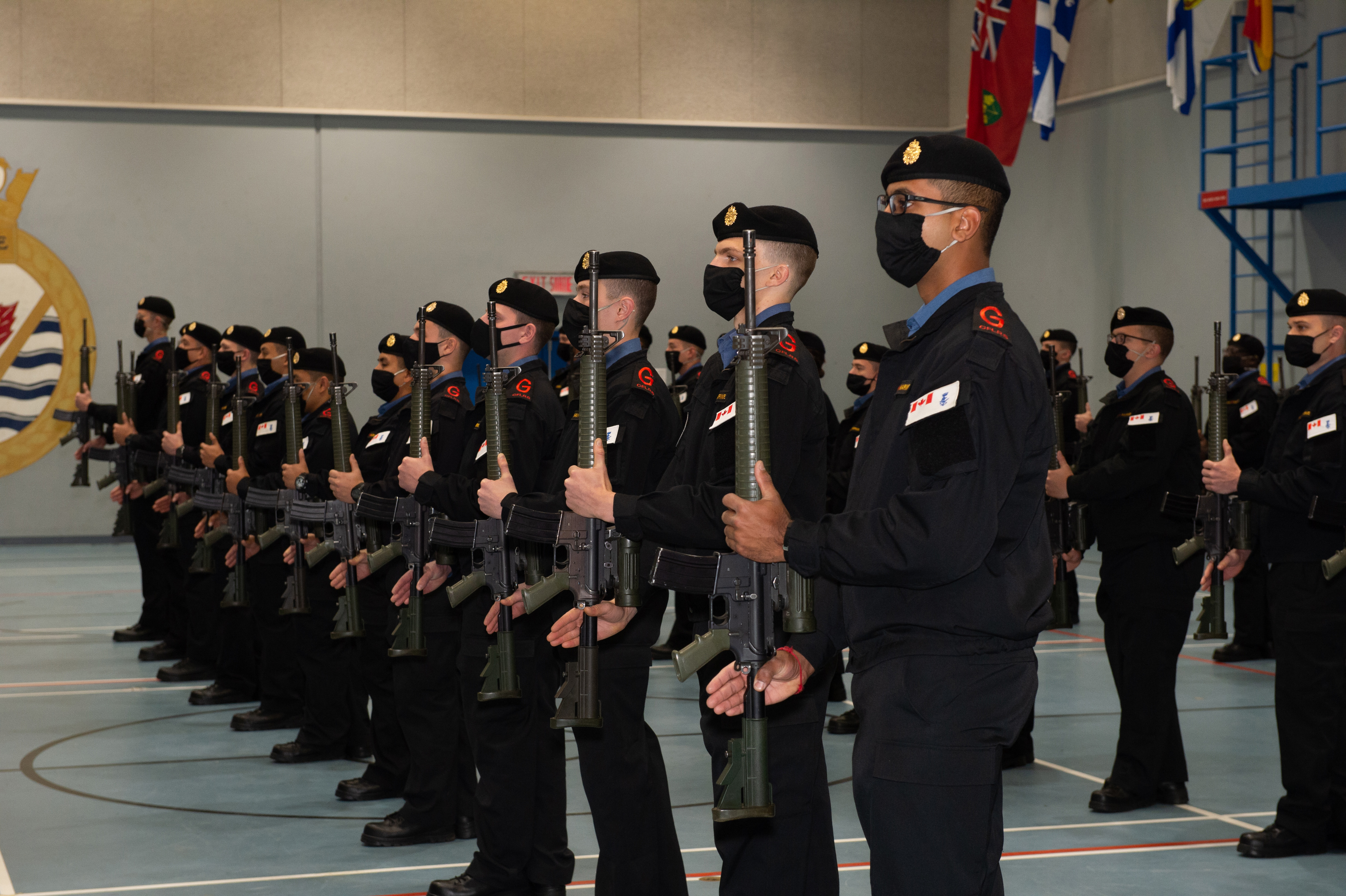 Recruits graduate from the East Coast De-centralized Basic Military Qualification training.