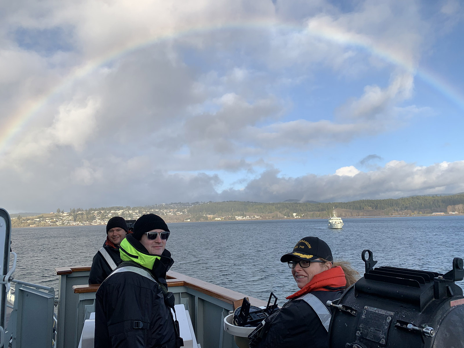 Commander of HMCS Brandon and her crew stand out on the bridge as a rainbow appears overhead as they participated in high readiness work ups off the coast of Victoria BC last week.