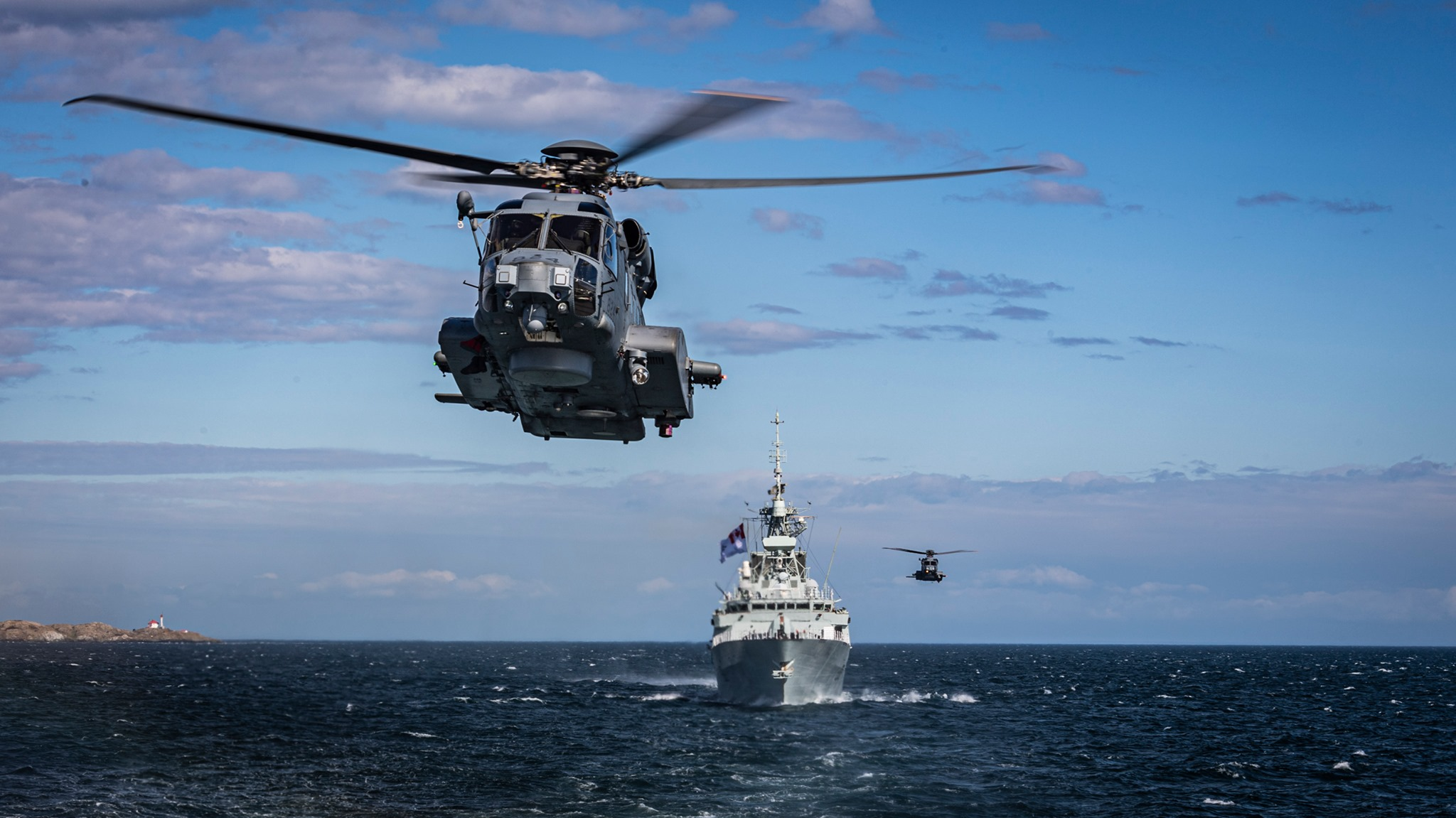 HMC Ships Winnipeg and Regina with embarked CH-148 Cyclone helicopters