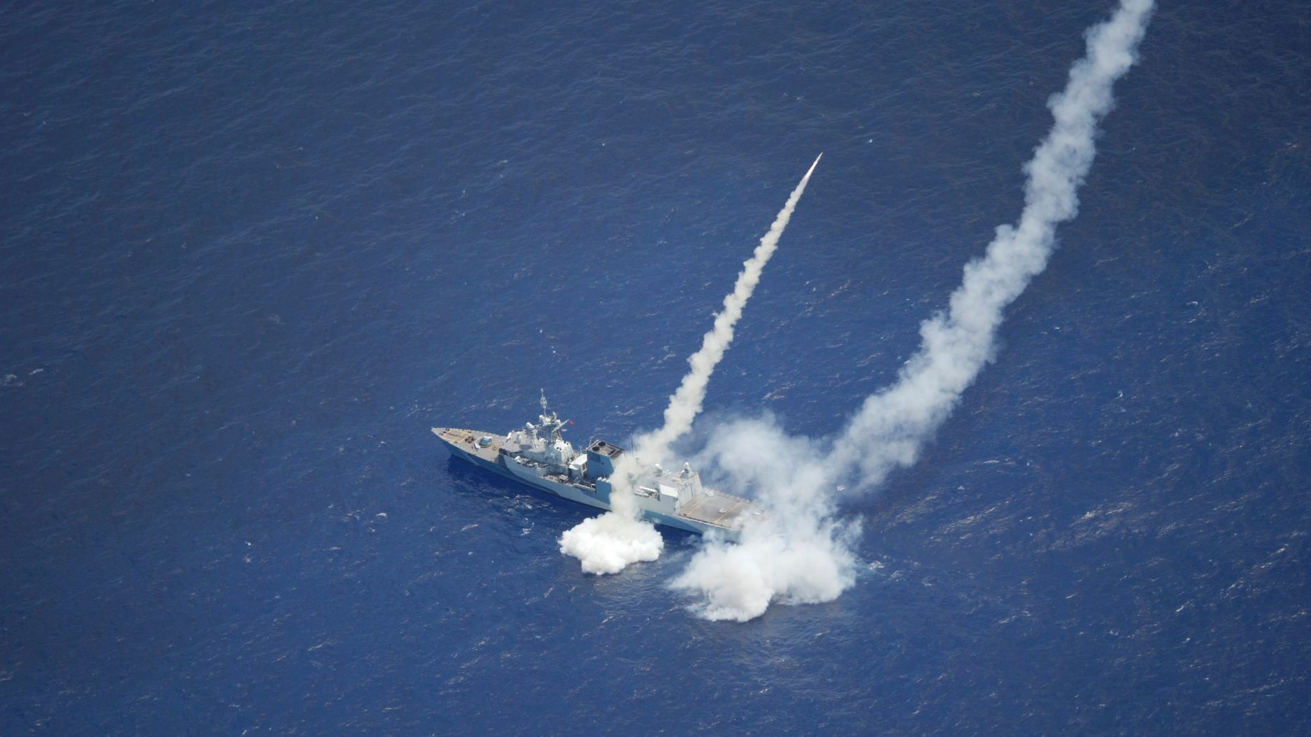 HMCS Regina fires two RGM-84 Harpoon Surface-to-Surface Missiles during RIMPAC 2020.