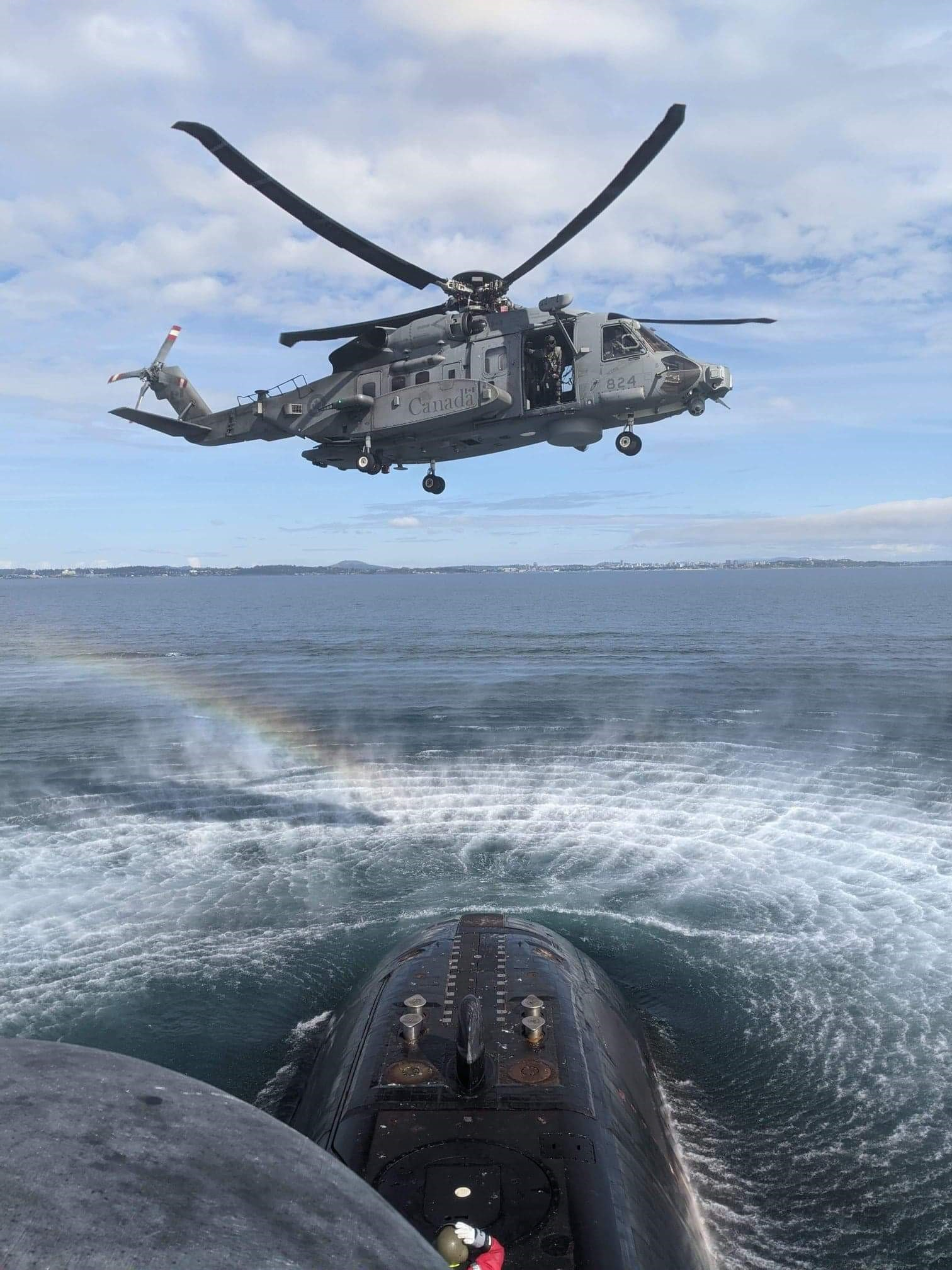 HMCS Victoria achieved another milestone as part of its ongoing sea trials when a CH-148 Cyclone helicopter hovered above to practice transferring equipment and personnel to the sub below – a first for a Victoria-class submarine and this new helicopter.