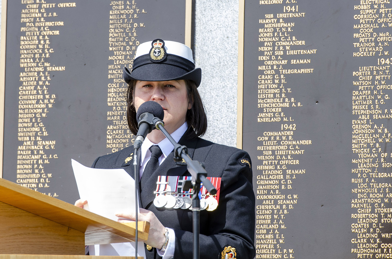 CPO1 Ginette Seguin speaks at a Battle of the Atlantic ceremony.