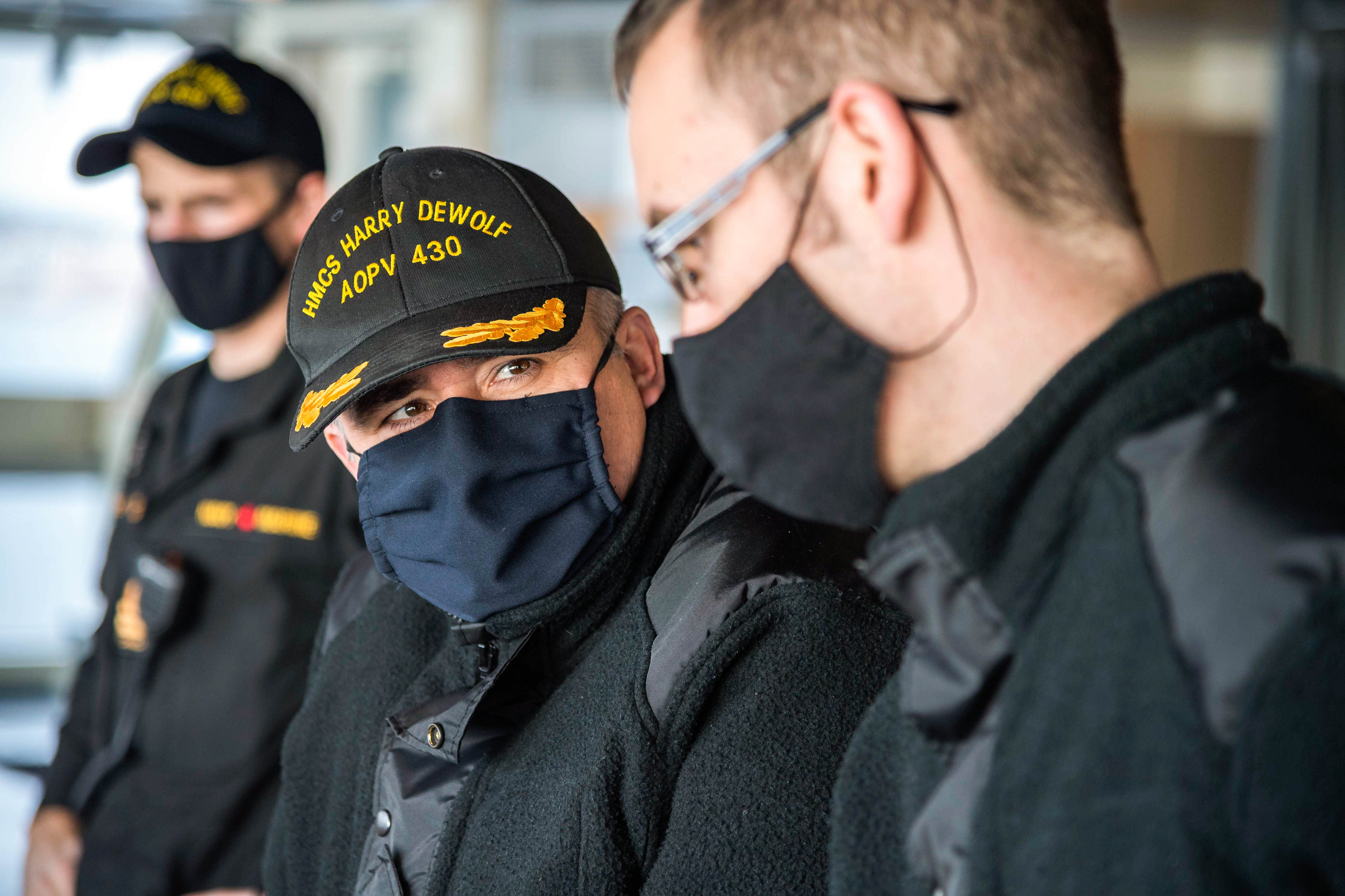Cdr Corey Gleason, Commanding Officer of HMCS Harry DeWolf, gives orders while conducting turning trials on November 9.
