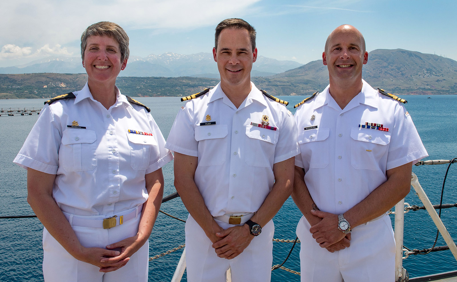 HMCS Toronto's Command Team poses on the foc'sle of the ship while in Souda Bay, Greece on June 13, 2019 during Operation REASSURANCE, ROTO 10.  Left to right:  Chief Petty Officer 1st Class Alena Mondelli (Coxswain), Commander Martin Fluet (Commanding Officer), Lieutenant-Commander Matthew Woodburn (Executive Officer).