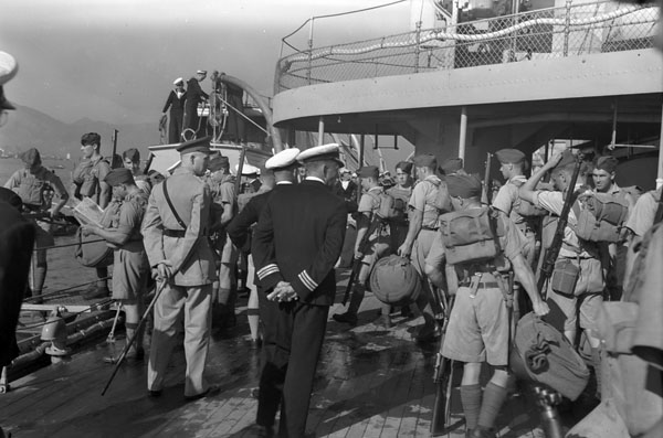 "Infantrymen of ""C"" Company (Royal Rifles of Canada) disembarking from HMCS Prince Robert, Hong Kong, November 16, 1941."