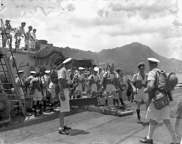 Landing party disembarking from HMCS Prince Robert during the liberation of Hong Kong, ca. 30 August 1945.
