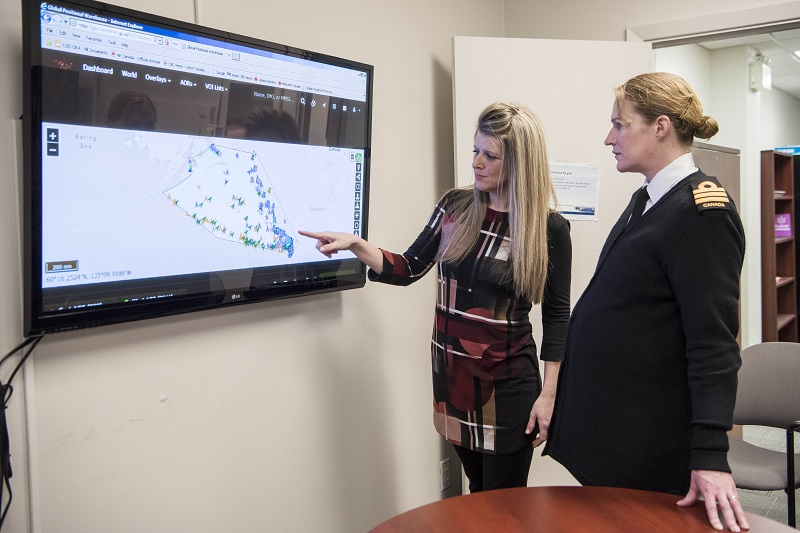 Alicia Hogue, a Programmer with the Royal Canadian Navy, demonstrates ship tracking software for Commander Seana Routledge of MARLANT's Base Information Services on 2 February, 2018 at Her Majesty's Canadian Dockyard Halifax.