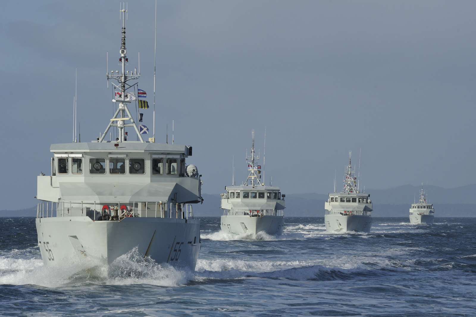 Patrol craft (training) boats Raven (hull number 56), Caribou (hull number 57), Renard (hull number 58) and Grizzly (hull number 60) sailing in formation during PCTS PHOTOEX, a joint exercise between 7 of the 8 West Coast PCT's in the staits of Juan de Fuca near Victoria BC on February 14th 2014.