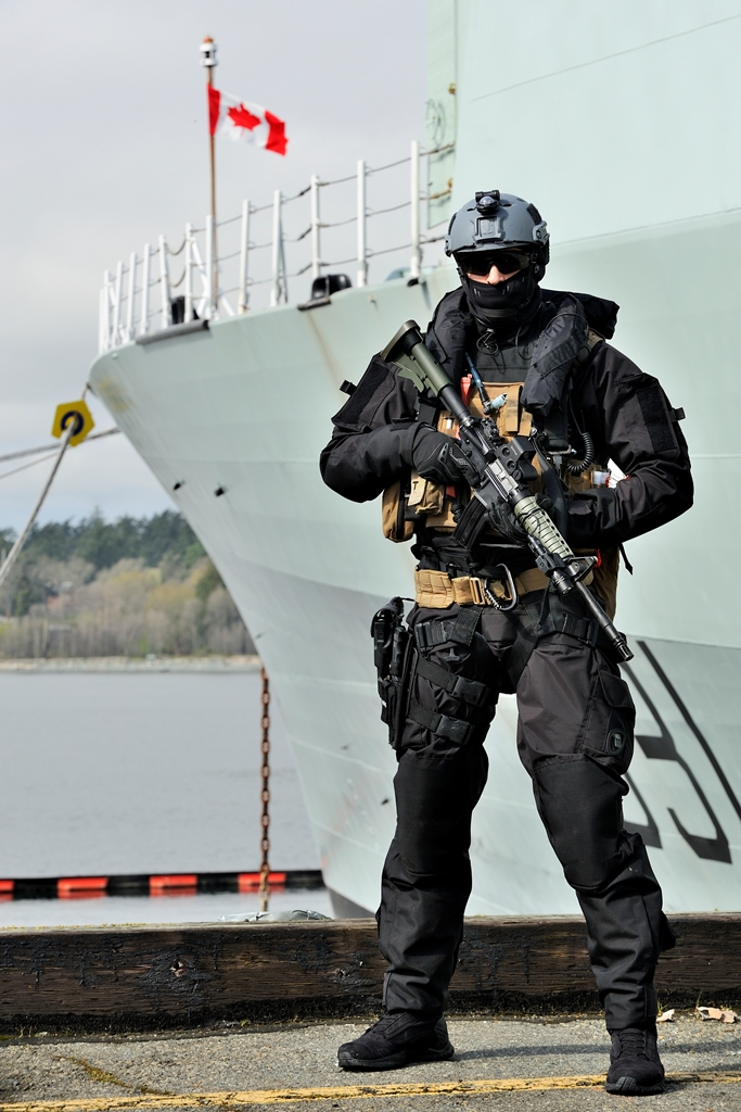 A member of the Maritime Tactical Operator Course stands watch on Alpha Jetty during a security exercise on March 26. LS Zachariah Stopa, MARPAC Imaging Services