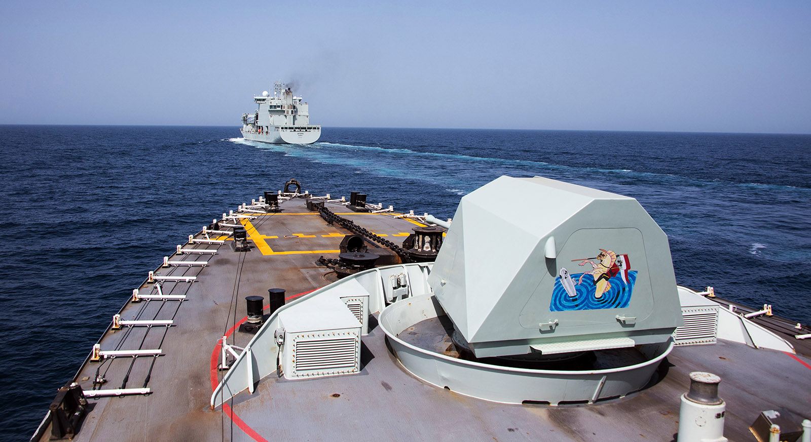 HMCS Regina and NRU Asterix conduct a replenishment at sea during Operation ARTEMIS in the Indian Ocean on May 1, 2019.