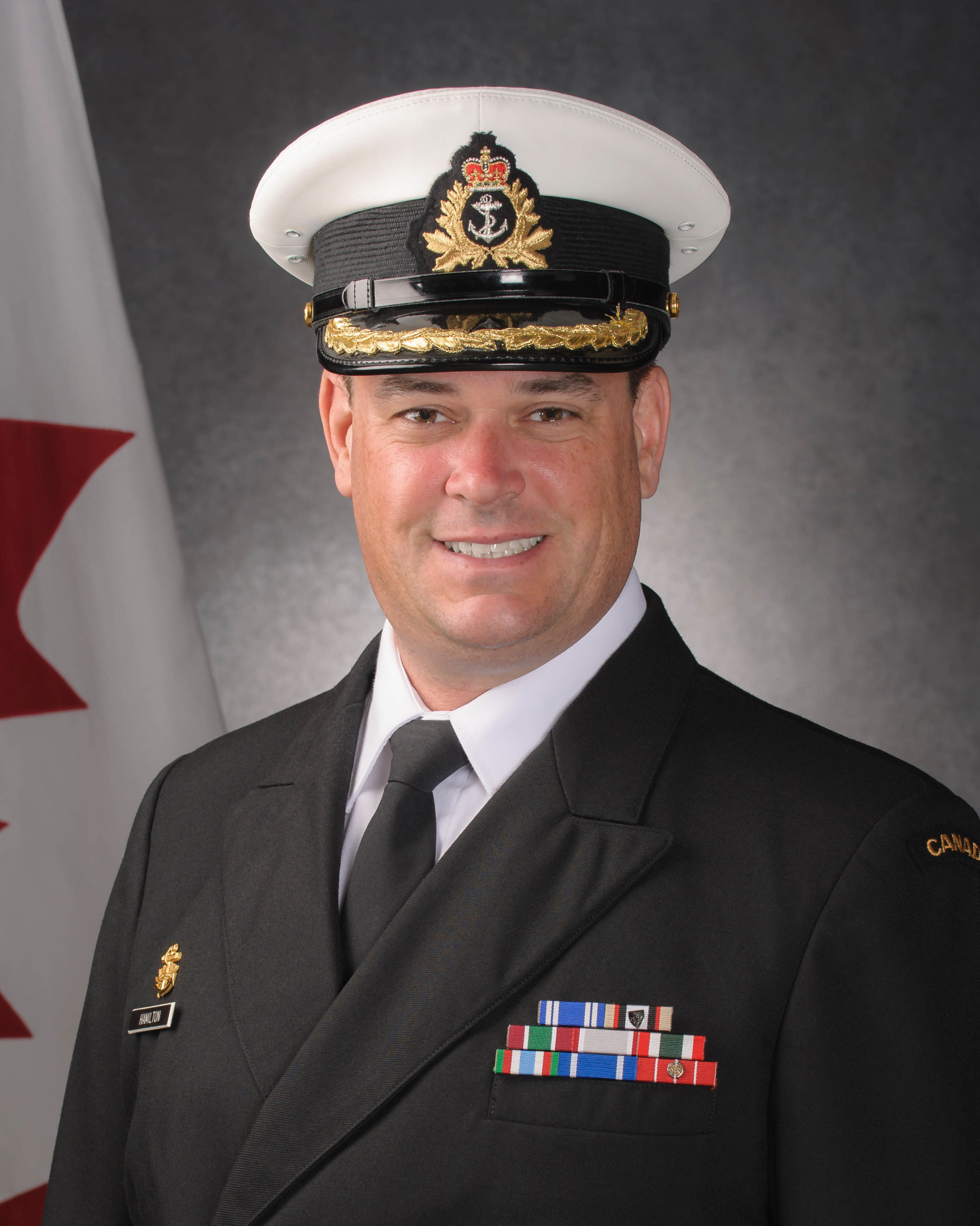 CAPTAIN(N) J.M. HAMILTON, MSM, CD