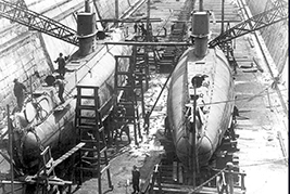 His Majesty's Canadian Ship CH-14 and CH-15 in dry dock in Halifax, circa 1920. In late 1919, Her Majesty's Submarines H-14 and H-15 arrived in Halifax from the Royal Navy. They were fully refitted at the Halifax Shipyard and were commissioned into the Royal Canadian Navy in April 1921.