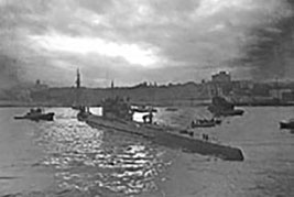 German Navy Submarine, U-190 arrives in St. John's Newfoundland in June 1945 after surrendering to Royal Canadian Navy sailors off the coast of Newfoundland on 12 May 1945. It was almost immediately commissioned into the Royal Canadian Navy as His Majesty's Canadian Ship U-190 for testing and evaluations.