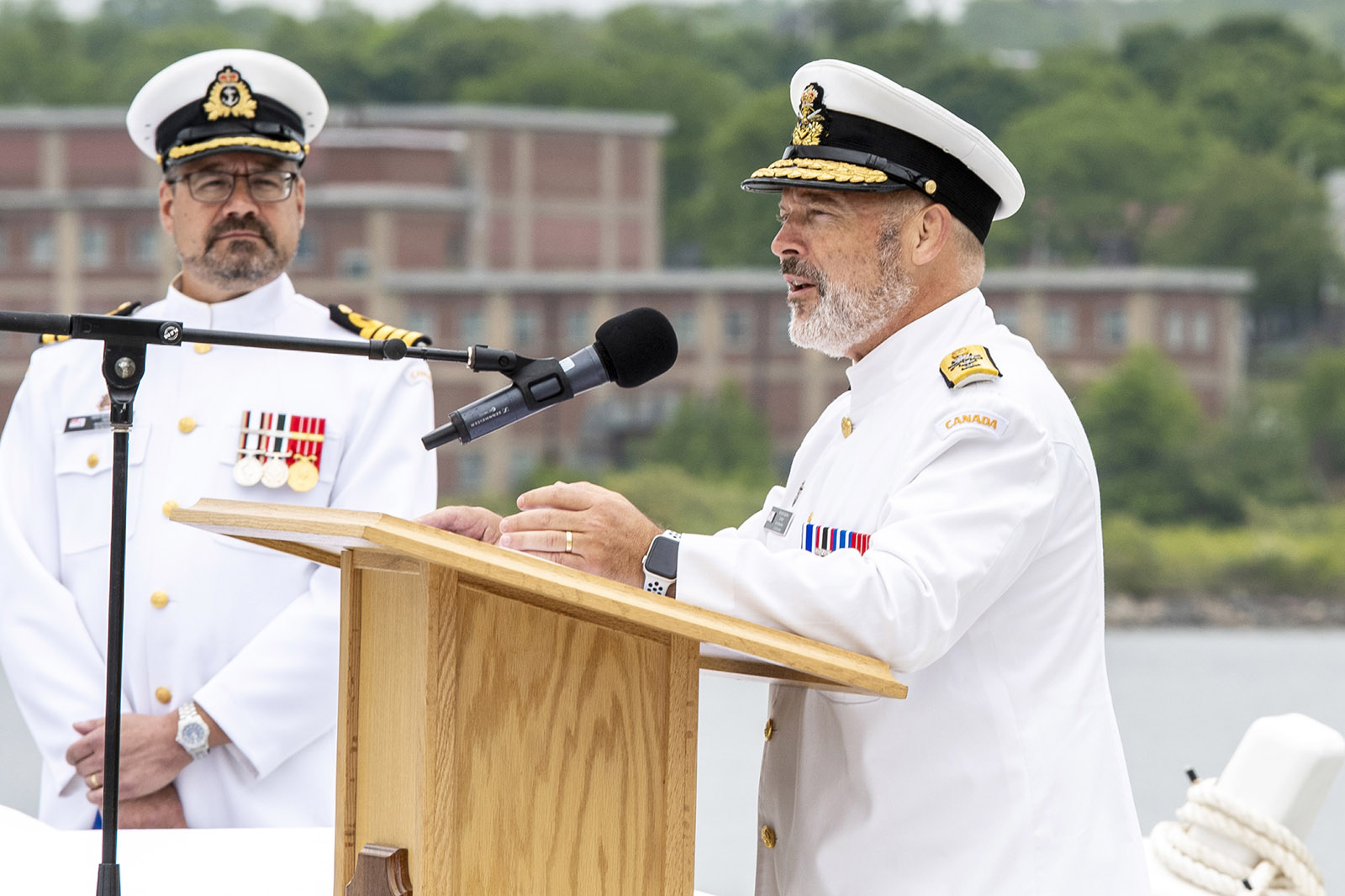 RAdm Baines gives his farewell address.