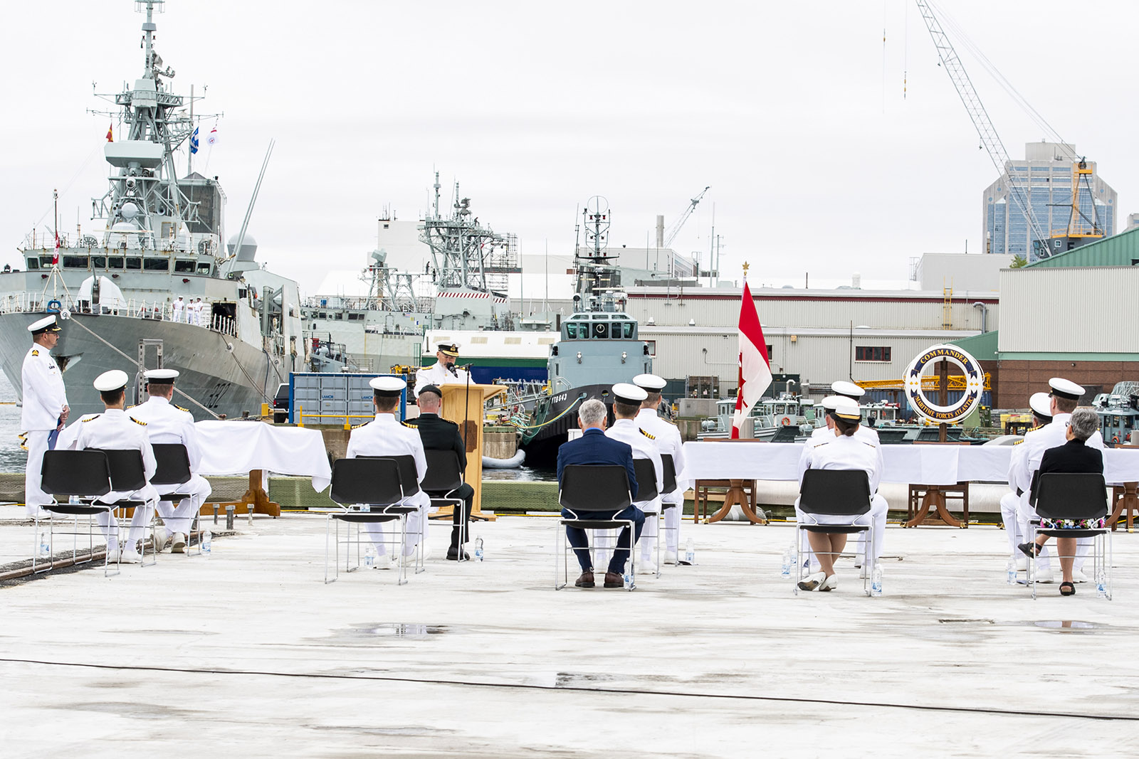 The change of command ceremony was held on the jetty in Halifax, with HMCS Ville de Québec as the backdrop.